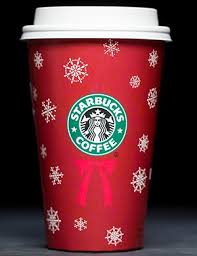 The Starbucks Logo Is Reminiscent Of An Evergreen Wreath In This Years Cup Design