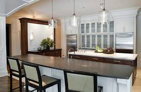 kitchen peninsula with mini bar and unique pendant lighting