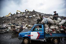 Landfill Photos From Six Cities That Highlight The Global Waste ... Belaz 75710 The Giant Dump Truck Hardy Services Size Comparison Of A Car The Largest Dump Truck And Workers Pass By One World Biggest Pictures Getty Images S Werelds Grootste Trekker Industrial Tyres Amsterdam Cath In Canada Biggest In 450ton Has Been Entered Guinness Book World Belaz Worlds Skyscrapercity Volvo Ce Unveils 60ton A60h Articulated Equipment Belaz Presents Scania Heavy Tipper For Higher Payloads Group Komatsu 830e 10 Trucks Claims Largest Title Trend