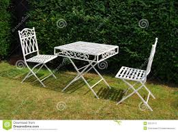 White Metal Garden Furniture Table And Two Chairs Stock Image ... Brompton Metal Garden Rectangular Set Fniture Compare 56 Bistro Black Wrought Iron Cafe Table And Chairs Pana Outdoors With 2 Pcs Cast Alinium Tulip White Vintage Patio Ding Buy Tables Chairsmetal Gardenfniture Italian Terrace Fniture Archives John Lewis Partners Ala Mesh 6seater And Bronze Home Hartman Outdoor Products Uk Our Pick Of The Best Ideal Royal River Oak 7piece Padded Sling Darwin Metal 6 Seat Garden Ding Set