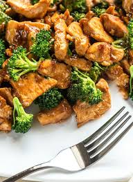 The Plated Chinese Chicken Broccoli Ready To Eat With A Fork Next It