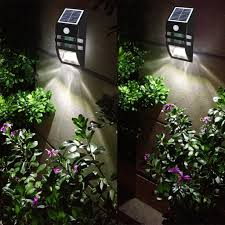 bright led solar power motion sensor wall light outdoor