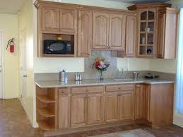 Flower Vase On Granite Kitchen Countertop For Decor Combine With Restaining Oak Cabinets Ideas