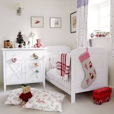 A Red And White Theme Is Staple To Christmas This Lovely Room Decorated Beautifully With Stockings Bedding Stuffed Toys
