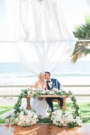 Salt Creek Beach Sweetheart Table With An Arch And Chandelier