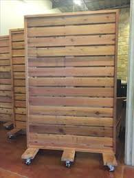 Shop Ideas Portable Wood Partition Maybe Make With Slat Wall Visual Merchandising Retail Store Display