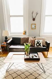 living room living room decor with black leather sofa brown