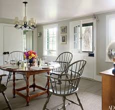Vintage Windsor Chairs Surround A Reproduction Tavern Style Table In The Kitchen Of Home