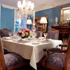 Traditional Blue Dining Room With Ornate Chandelier And Fancy Table Setting