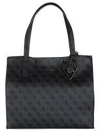 sac toile ou cuir porté épaule femme en