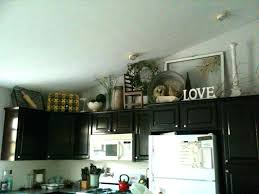 Decorate Above Kitchen Cabinets Best Decorating Ideas On Cabinet Decor
