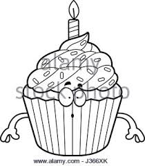 A cartoon illustration of a birthday cupcake looking surprised Stock