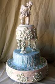 Artistic Three Tier Wedding Fountain Cake Design In Blue And Ivory Decorated With A Classic Bridal Groom Figurine Topper