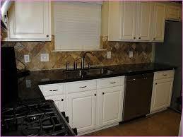 Cream Kitchen Cabinets With Black Granite Countertops