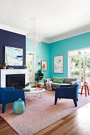 Navy Blue Accent Wall Color With Teal Paint For Relaxing Family Room Ideas Using Two Colors Combination Chic Round Shaped Coffee Table