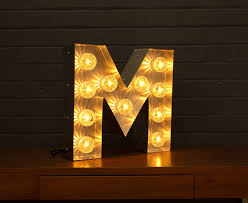 light up marquee bulb letters m by goodwin & goodwin