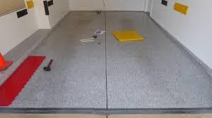 Racedeck Flooring Vs Epoxy by Installing Racedeck Garage Flooring