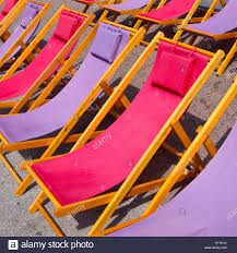 Classic Wooden Beach Chairs In Purple And Pink Stock Photo ... Best Promo 20 Off Portable Beach Chair Simple Wooden Solid Wood Bedroom Chaise Lounge Chairs Wooden Folding Old Tired Image Photo Free Trial Bigstock Gardeon Outdoor Chairs Table Set Folding Adirondack Lounge Plans Diy Projects In 20 Deckchair Or Beach Chair Stock Classic Purple And Pink Plan Silla Playera Woodworking Plans 112 Dollhouse Foldable Blue Stripe Miniature Accessory Gift Stock Image Of Design Deckchair Garden Seaside Deck Mid
