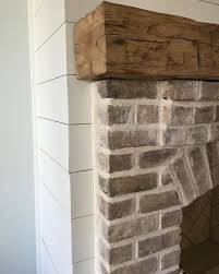 Whitewashed Brick Rustic Wood Mantel Shiplap FireplaceFarmhouse