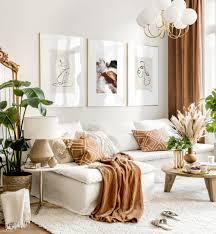 wanddeko wohnzimmer line bilder goldrahmen