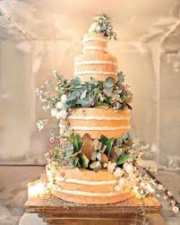 This One Looks A Little Bit Complex But I Like That Its Mostly Greenery For Their Italian Nuptials John Legend And Chrissy Teigen Chose Four Tiered