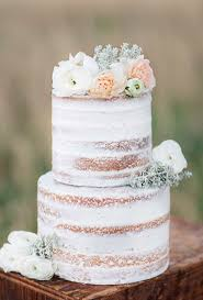 A Thinly Frosted White Wedding Cake Topped With Pale Petals By Angel Delights