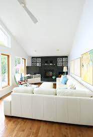 Living Room With Fireplace In Corner by Rearranging The Living Room With Our Modern White Leather