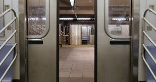 An interior view of the doors on a New York City subway car as