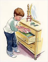 Boy Putting Clothes In Drawer