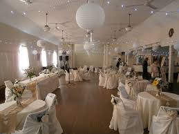 Latest Vintage Wedding Decorations Ideas With Pendant Lamps And Round Tables Also White Upholstery Chairs Plus