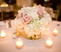 The Beauty Of A Beach Wedding Is That You Can Go As Simple Like With Your Tables Pink And White Centerpiece On Light Tan Tablecloth Fits
