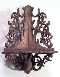 Nineteenth Century German Rustic Corner Shelf Composed Of Stripped Wood Carved With Arboreal And Floral Filigree