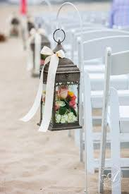 Beach Wedding Aisles Wooden Lanterns With Flowers Lining The Aisle