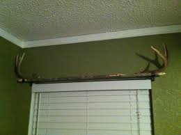 homemade curtain rod a long straight branch with antlers for end