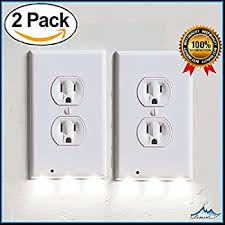 lighted wall outlet coverplate with automatic light