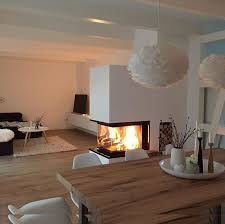 lovely fireplace in the middle of the room wohnen