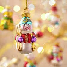 Hanging Snowman Christmas Ornament With Out Of Focus Ornaments In