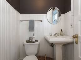 cottage powder room with wainscoting high ceiling in portland