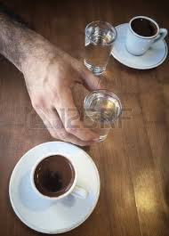 A Cup Of Turkish Coffee And Water Glass On Wooden Table Stock Photo