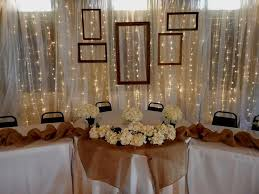 Head Table Backdrop Rental X Draped In Chiffon Fairy Lights And Rustic Picture Frames Custom Pipe Drape Structure Offered By Moments Time Wedding