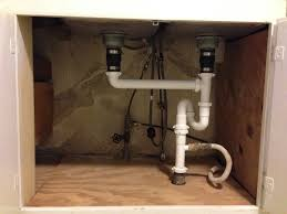 cabinet kitchen sink plumbing repair leaky sink basket strainer