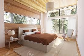 holz schlafzimmer interieur mit bett holzstirnwände und große fenster mit blick in die natur