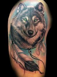 Combining The Dream Catcher And Wolf This Imaginative Tattoo Is Perfect For Those Who Love Both With A Light Blue Background Large Feather At