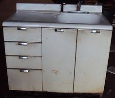 vintage cast iron enameled sink and metal cabinets much like mine