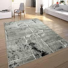 designer teppich modern trendig meliert steinoptik mauer muster wohnzimmer grau