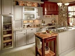Kitchen Design Ideas With White Wellborn Cabinets Plus Sink And Chandelier