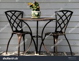 100 Small Wrought Iron Table And Chairs Black On Stock Photo Edit Now 706011961