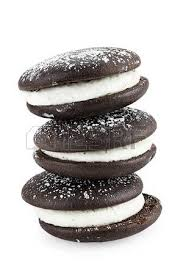 Stack of whoopie pies or moon pies isolated on a white background with light shadow