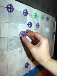 Cutting Glass Tile Backsplash Wet Saw by How To Install A Marble Tile Backsplash Hgtv