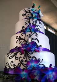 Fondant wedding cake with purple satin ribbon black piped scrolls and fresh orchids 929